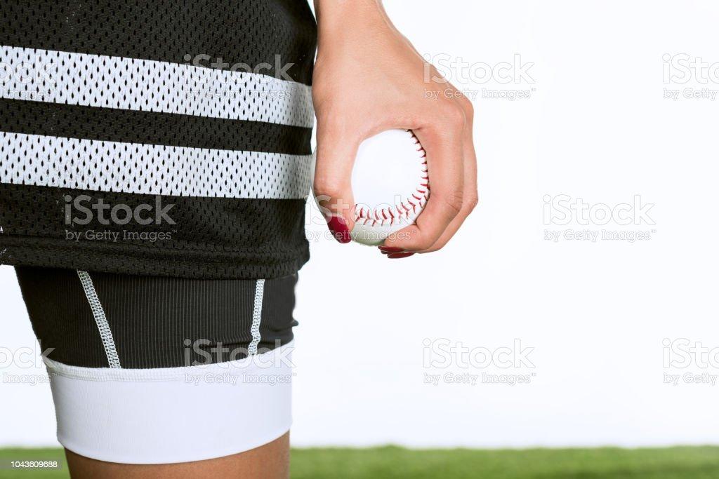 cropped shot of woman holding baseball ball isolated on white stock photo