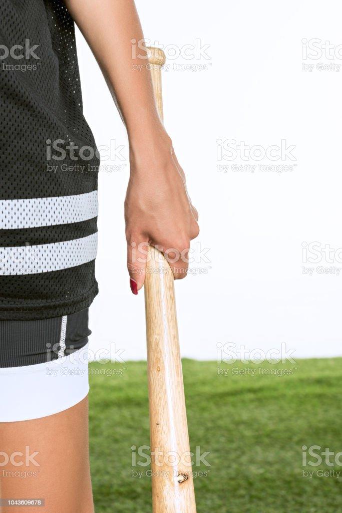 cropped shot of woman holding baseball bat isolated on white stock photo
