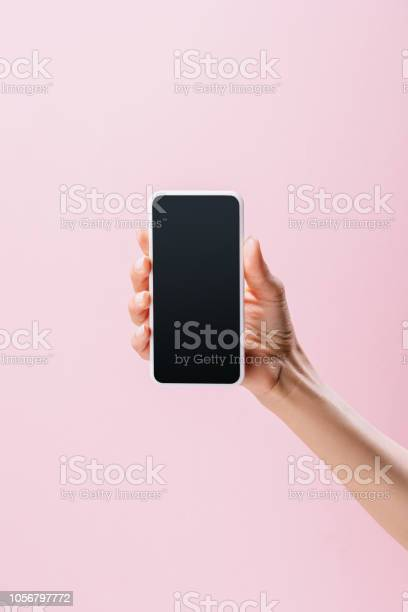 Cropped shot of woman holding smartphone with blank screen isolated picture id1056797772?b=1&k=6&m=1056797772&s=612x612&h=ou27 uj7etobifevk1f1vqnklhvnlemy1wdhqn3dbh0=