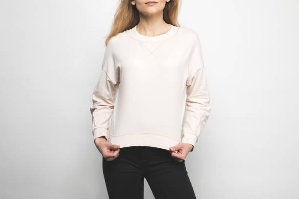 cropped shot of woman in blank sweatshirt on white - sweatshirt stock photos and pictures