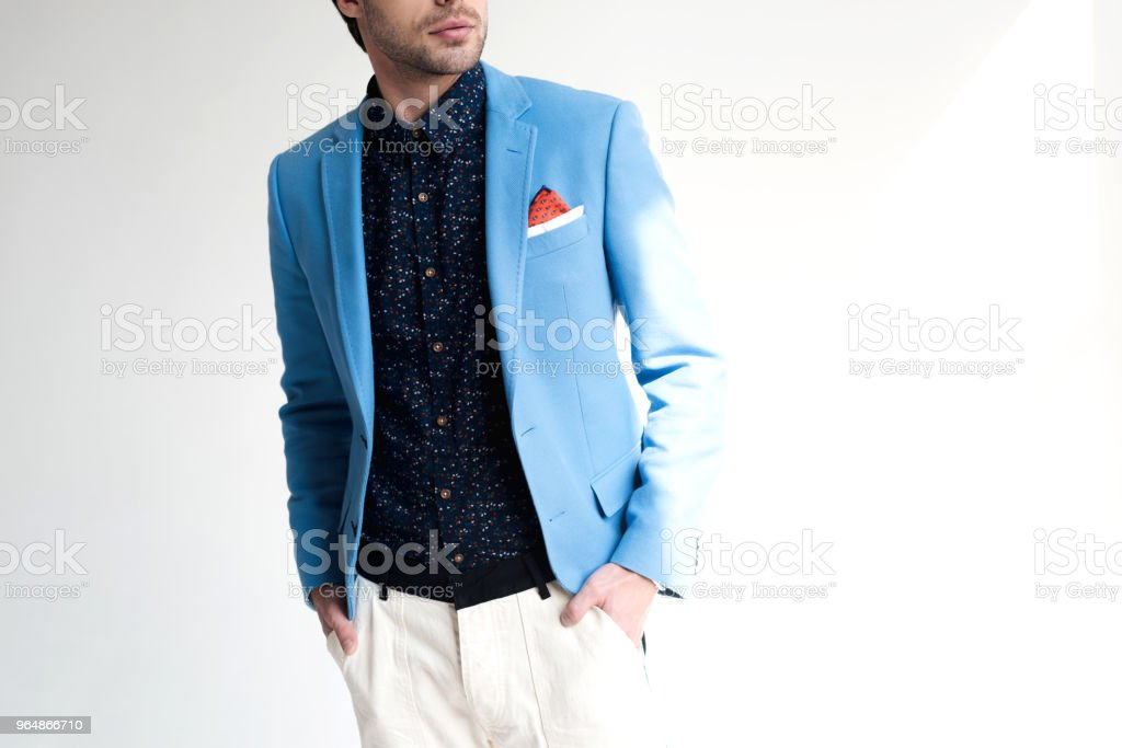cropped shot of young man in stylish blue jacket on white royalty-free stock photo