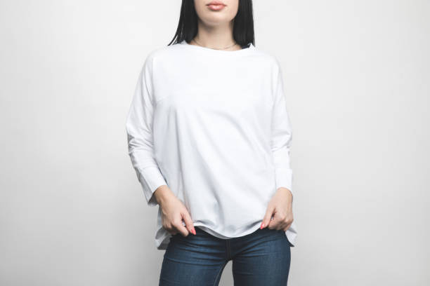 cropped shot of young woman in blank sweatshirt on white cropped shot of young woman in blank sweatshirt on white long sleeved stock pictures, royalty-free photos & images