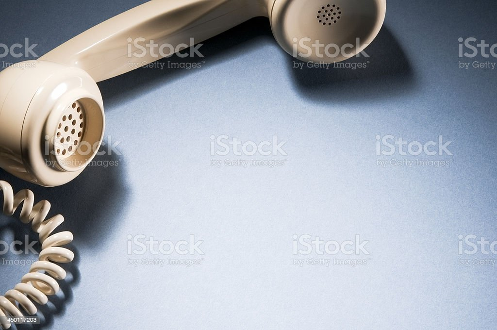 Cropped Telephone receiver and cord with copy space royalty-free stock photo