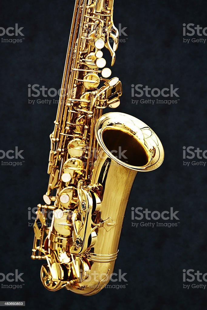 Cropped vertical shot of golden sax on black background stock photo