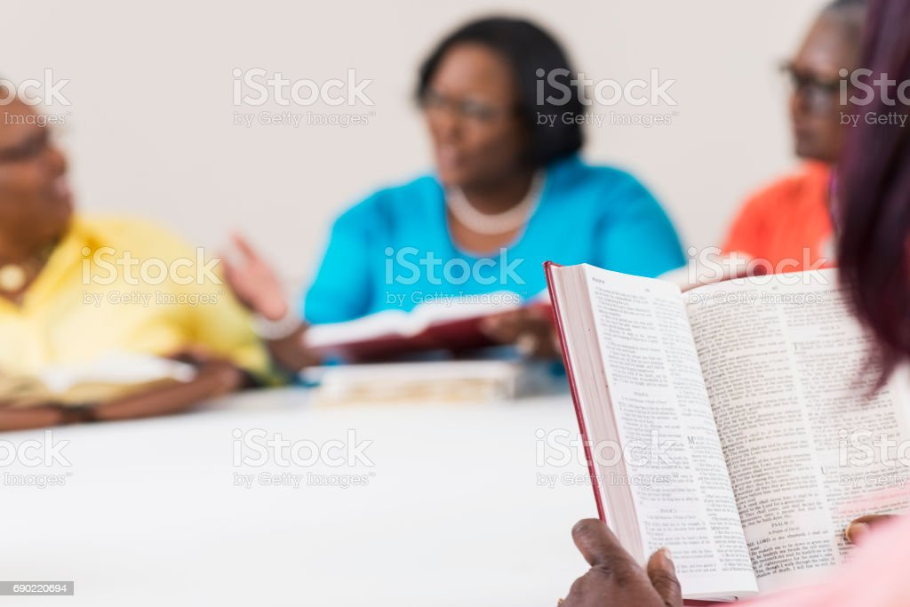 Cropped view of bible study group stock photo