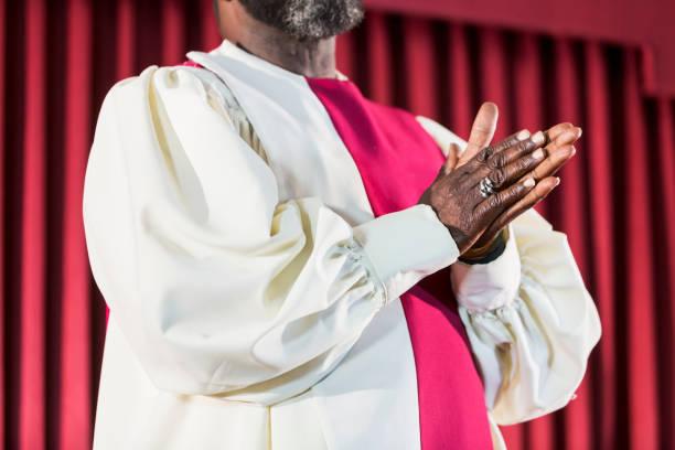 Cropped view of black man in church choir robe stock photo
