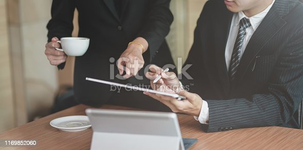 1068752548istockphoto Cropped view of businessman show informations 1169852060
