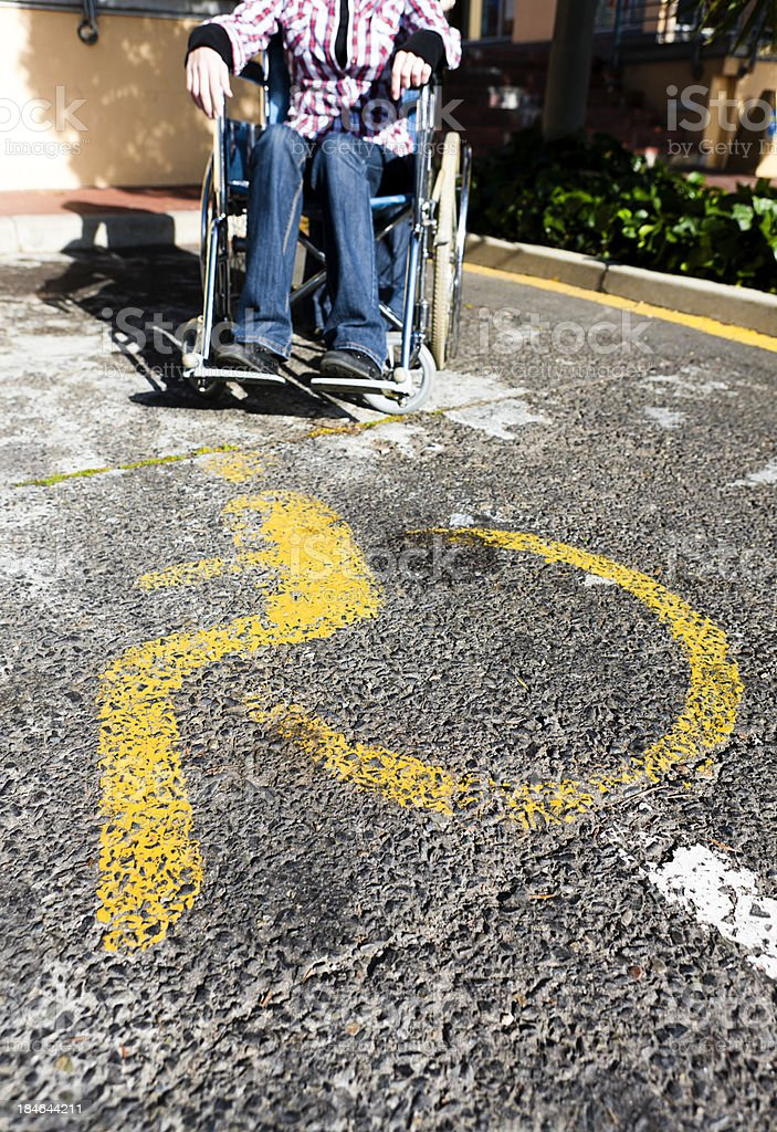 Cropped view of disabled parking sign with person in wheelchair royalty-free stock photo