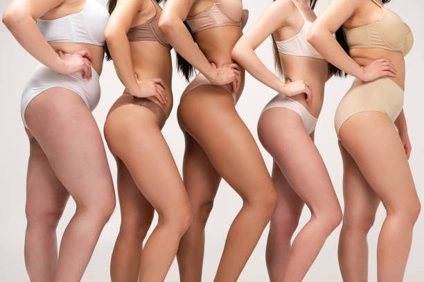 cropped view of five multiethnic women in underwear posing with hands on hips isolated on grey, body positivity concept cropped view of five multiethnic women in underwear posing with hands on hips isolated on grey, body positivity concept body positive stock pictures, royalty-free photos & images