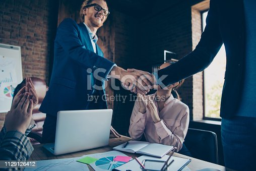 Cropped view of hands shake nice chic elegant cheerful business sharks experts welcome new participant congrats greetings appointment at modern industrial loft interior work place station