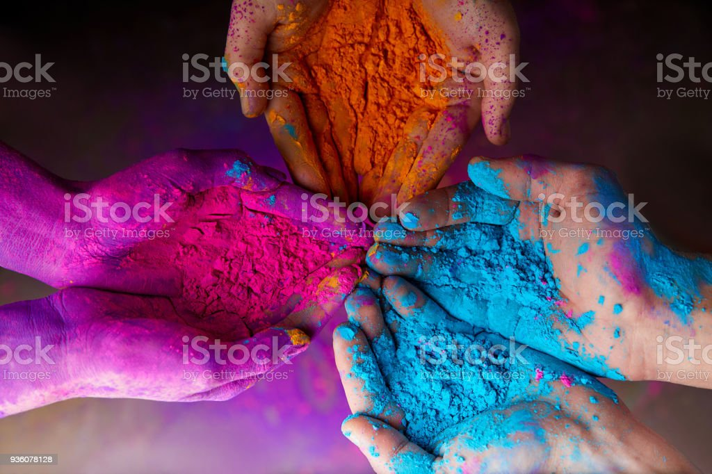 cropped view of hands with holi powder for Hindu spring festival of colours stock photo