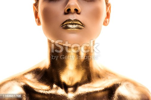 cropped view of naked woman painted in golden isolated on white