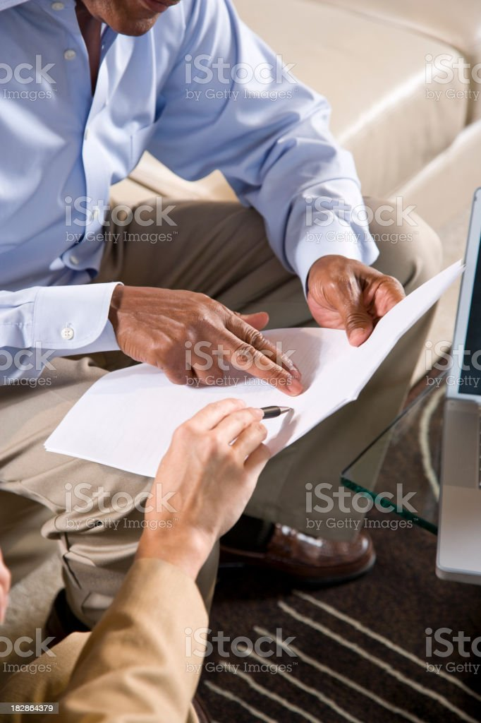 Cropped view of people pointing to a business document stock photo