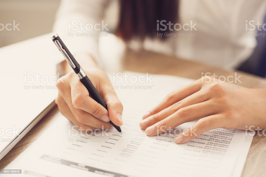 Cropped View of Person Working with Document stock photo