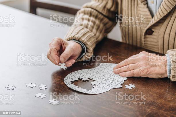 Cropped view of senior man playing with puzzles picture id1089332974?b=1&k=6&m=1089332974&s=612x612&h=lfcvrxbamezqvb6m4y0tfneitwtocij6svzbz pkumq=