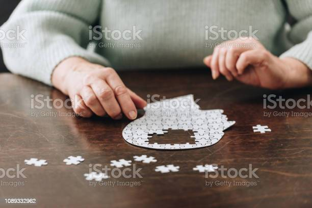 Cropped view of senior woman playing with puzzles on table picture id1089332962?b=1&k=6&m=1089332962&s=612x612&h=s36tlaiiyozxz9ctc8vwh6ggmqt8tjxqksfgowrwyiq=