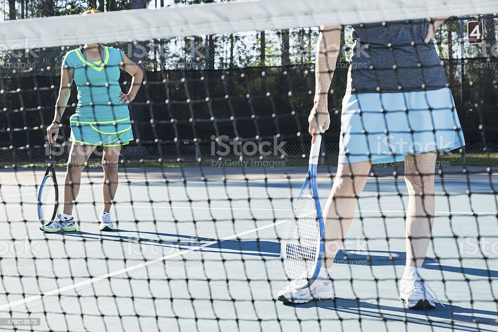 Cropped view of tennis players royalty-free stock photo