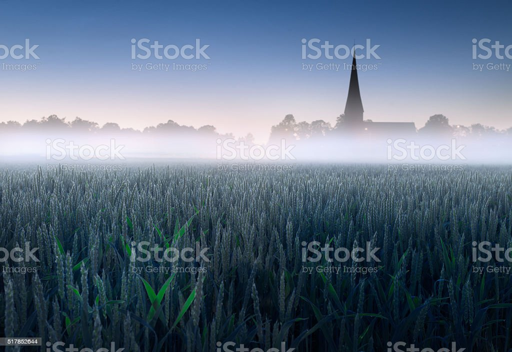 Crops and church stock photo