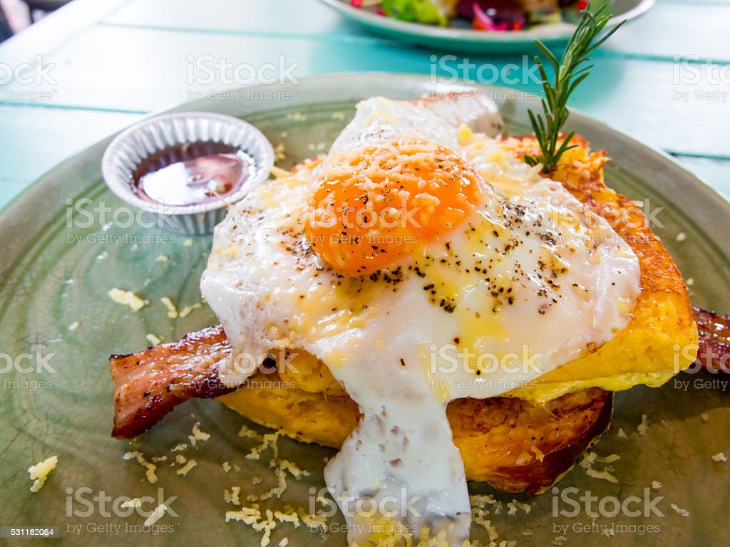 Croque madame delicious french breakfast with bacon, cheese, egg stock photo