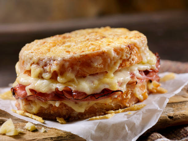 Croque Monsieur, Grilled Cheese Sandwich with Black Forest Ham, Gruyere and Bechamel Sauce stock photo