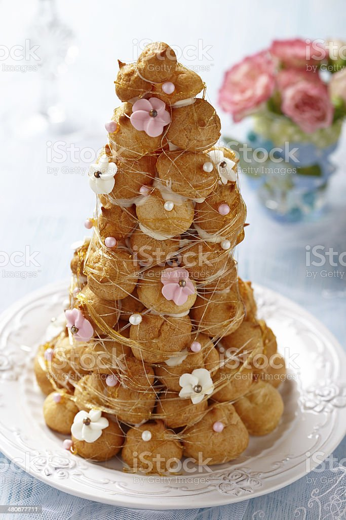 Croquembouche with Pink and White Frosting Roses stock photo