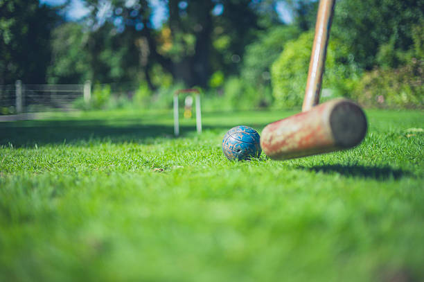 Croquet mallet hitting ball – Foto