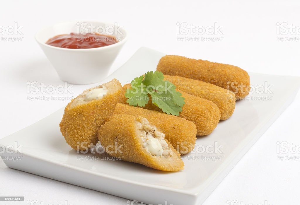 Croquettes on a white platter with sauce royalty-free stock photo