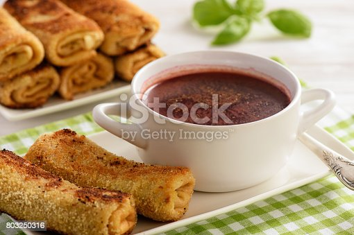 istock Croquettes polish style pancakes stuffed with beef and beetroot soup. 803250316