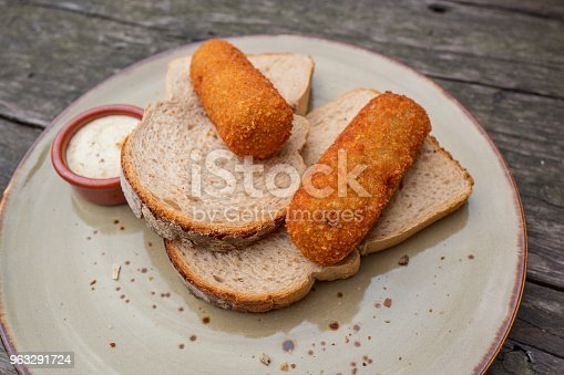 istock Croquettes with bread. 963291724