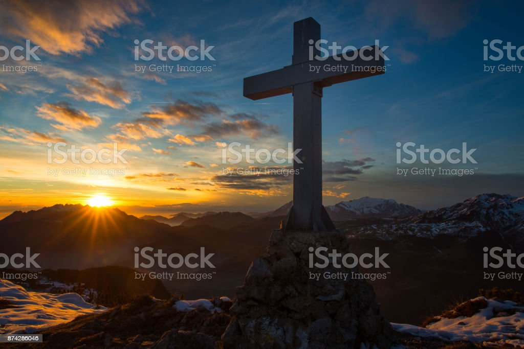 Cross a mountain in the magical sunset colors stock photo