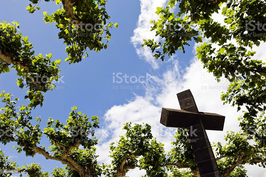 Cross above the trees royalty-free stock photo