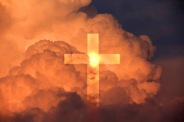 Cross against clouds – zdjęcie