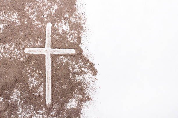 cross and ash on white background - symbol of ash wednesday. copy space - ash cross stock photos and pictures