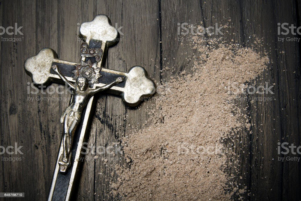 Cross and ash - symbols of Ash Wednesday. stock photo