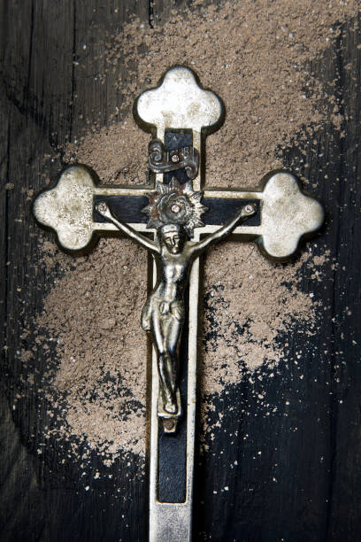 cross and ash - symbols of ash wednesday. - ash cross stock photos and pictures