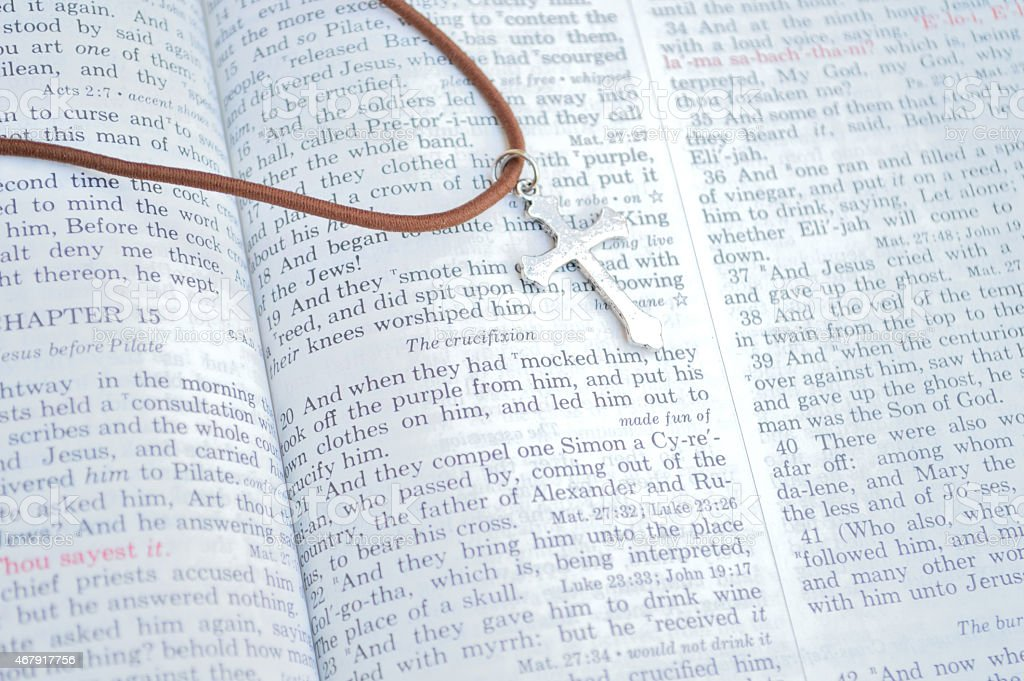 Cross and Bible, Good Friday scripture stock photo