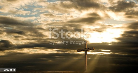 istock Cross and Dramatic Sky with sun rays and dark clouds 120924816