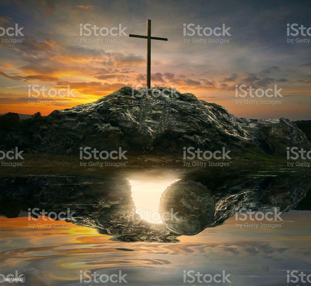 Cross and empty tomb stock photo