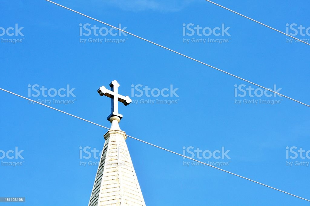 Cross and Power Lines stock photo