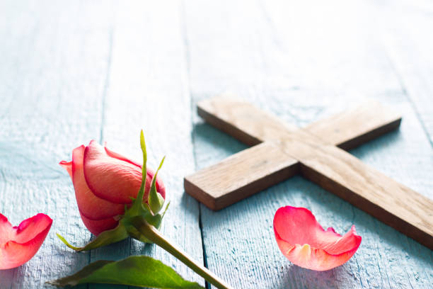 Cross and rose abstract easter religion concept background stock photo