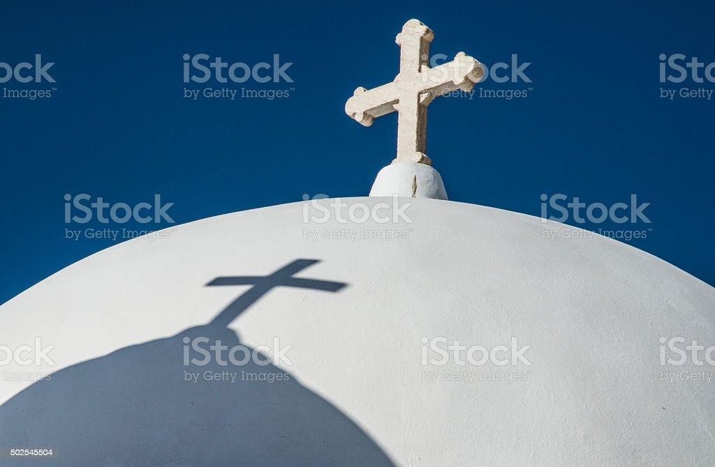 Cross and shadow stock photo