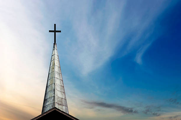 XXL cross and steeple stock photo