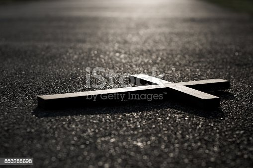 istock Cross and sunset on road in dark tone , religion peace freedom concept 853288698