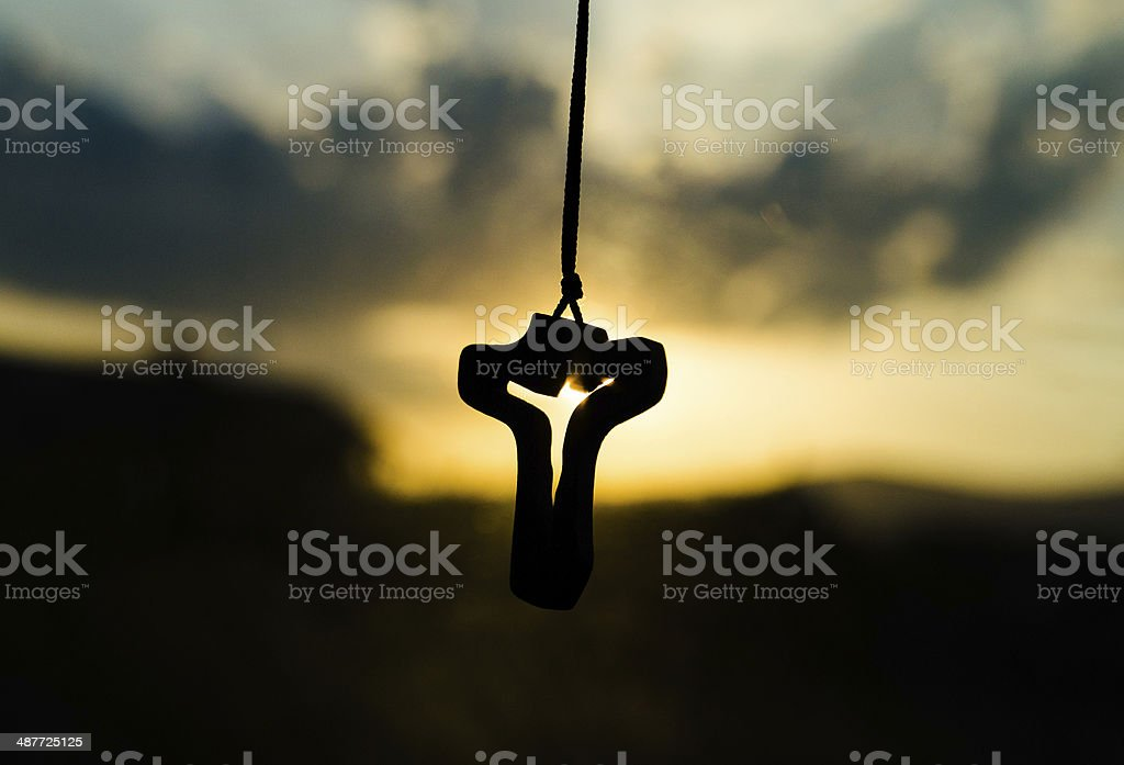 Cross and sunset stock photo