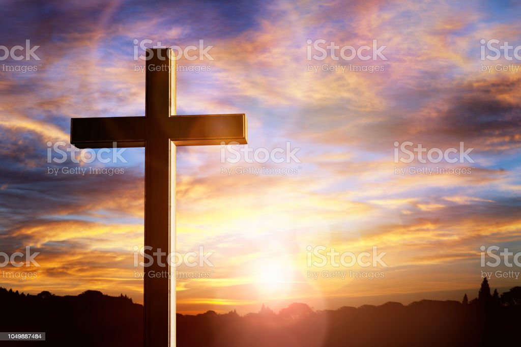 Cross at sunset, crucifixion of Jesus Christ stock photo
