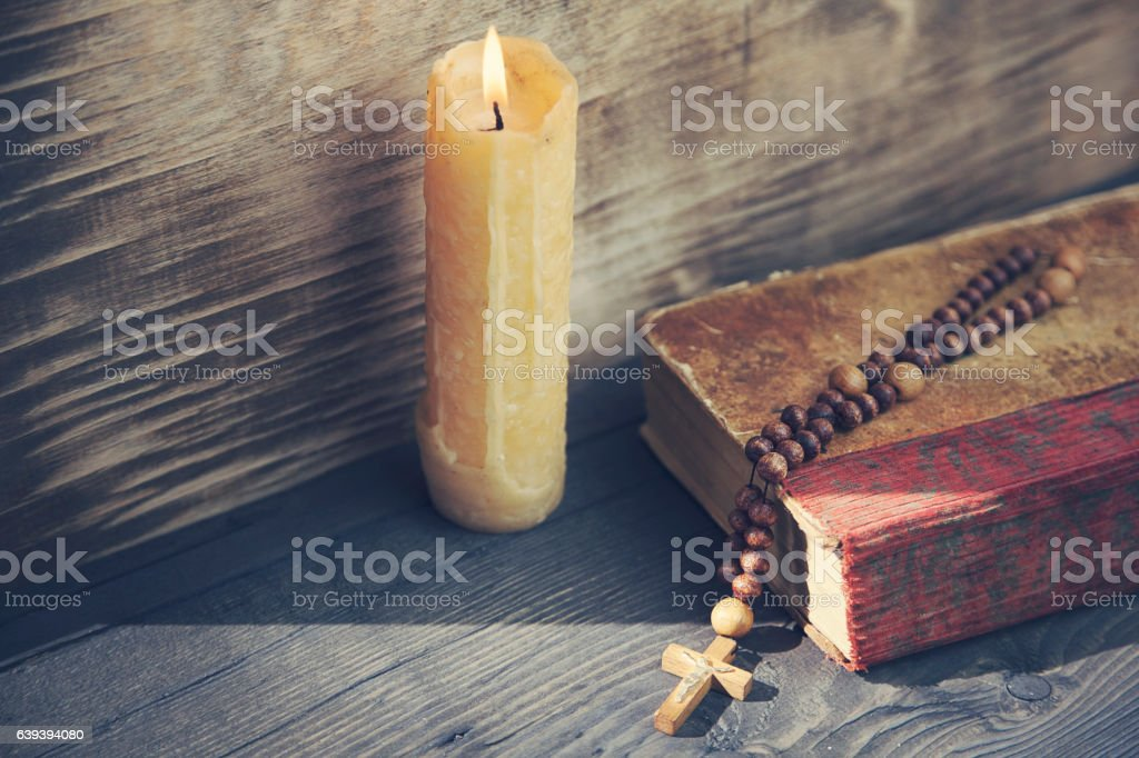 cross, book and candle stock photo