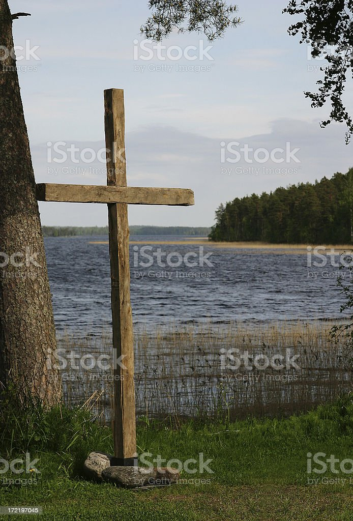 cross by the lake stock photo