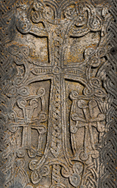Cross carved into Armenian khachkar Close-up of crosses carved into a centuries-old khachkar at Noratus cemetery in Armenia. Khachkars, also known as Armenian cross-stones, are widespread in Armenia. armenian culture stock pictures, royalty-free photos & images