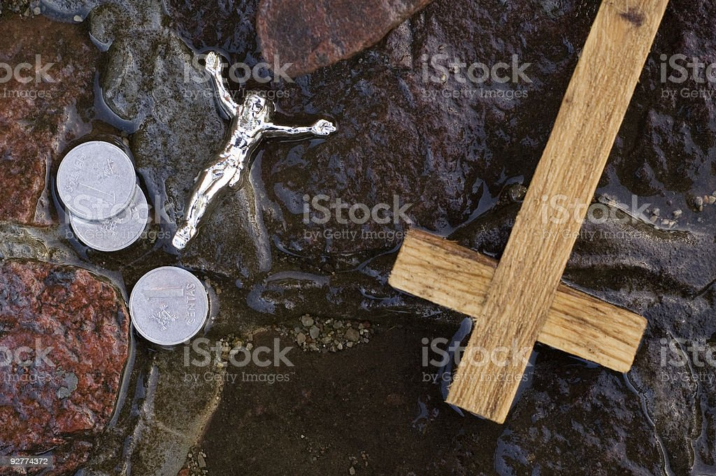 Cross, coins and Jesus figure. stock photo