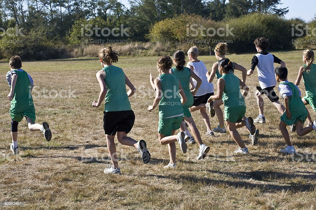 Cross Country Runners Leave the Starting Line royalty-free stock photo